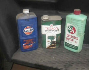 Vintage outboard oil tins, price reduced