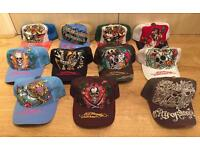 8 brand new Ed Hardy / Christian Audigier Men's baseball caps and 3 once used caps. All authentic