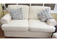 2 seater settee with 2 matching footstools, and a complete set of unused spare covers