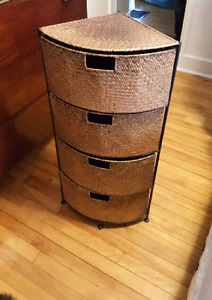 Wicker corner drawers.