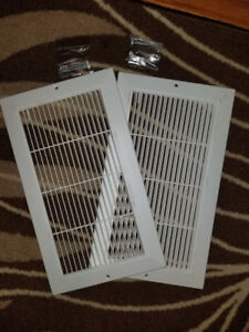 2 white vent covers with screws