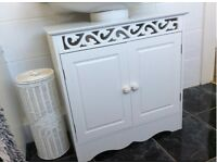 White two door under the sink cupboard Simlt slides underr the bath room sink brand new never used