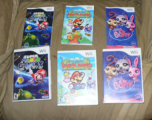 4 Nintendo Wii games,paper Mario, Mario galaxy,Rayman pat shop