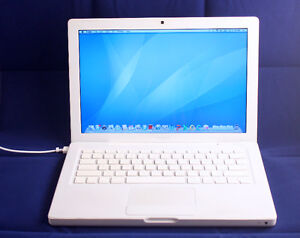 Apple Macbook with charger and a brand new battery