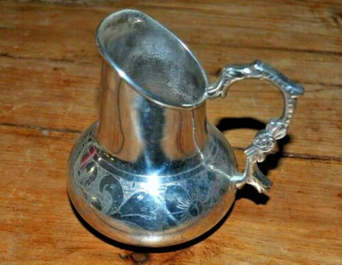 "ANTIQUE SILVER BOLIVIAN CREAMER JUG WITH FLOWER  DESIGN 4 1/2"" HIGH"