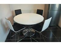 White table with 4 leather chairs