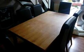 Dining table and 6 brown leather chairs in excellent condition