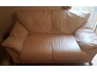 CREAM LEATHER TWO SEATER SOFA IN VERY GOOD CONDITION FREE LOCAL DELIVERY