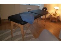 Fit and friendly male offers a relaxing massage