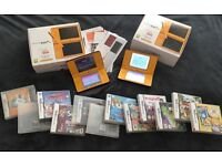 2 X NINTENDO DSI XL's for sale boxed with manuals and 12 games great Christmas presents
