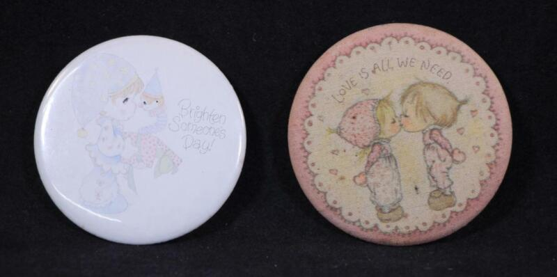 Two Different Vintage Hallmark Pin Back Buttons. Precious Moments & Betsey Clark
