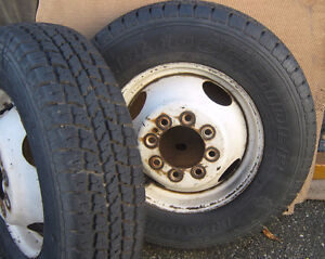 Two , 8 bolt  1 ton rims and tires , Dually coined Motorhome