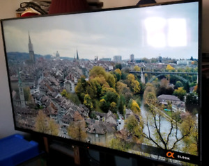 """Selling 60"""" LED Smart Screen TV w/ TV and mount."""