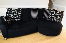 Black fabric sofa with arm chair and footstool