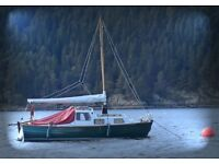 classic clinker Mahogany on Oak motor sailor with launching trailer.
