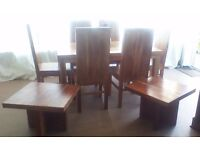 Large chunky table & 6 chairs in acacia wood. Also 2 matching coffee tables
