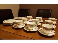 Variety of vintage-style tea cups, saucers and plates