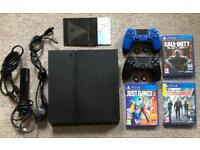 **Ps4 500gb, 2 controllers, Camera, 4 Games & thumb grips**