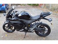 Black Yamaha YZF damaged