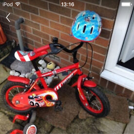 Toddlers bike with stabilisers and helmet