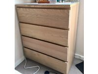 Chest of drawers with glass top