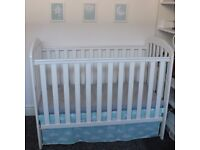 White wooden baby cot bed