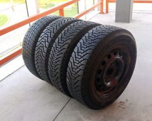 Set of four 185/70/14 winter tires on 4x100 rims. Excellent cond