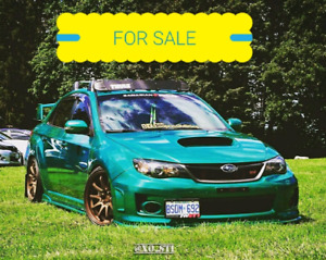 2011 subaru sti sport-tech $26,000 or best offer.