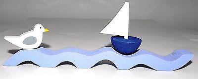 Welle -  Kunsthandwerk - per Hand gesägt und bemalt (für den Innenbereich) ()