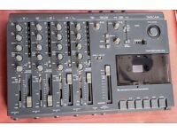 Tascam compact, 4-channel tape deck.