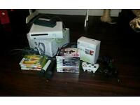 Xbox 360 plus 14 games 3 controllers an 2 mics