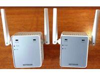 Two NETGEAR Mini N300 Mbps Wi-Fi Range Extenders with External Antennas