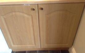 Kitchen cupboards in good condition light oak doors.