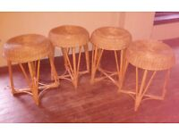 Set of four wickerwork stools, light and easy to move but stable.