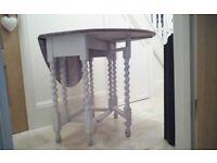 Dropleaf oak dining table