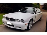 An immaculate Jaguar XJ8 3.5 Litre V8 SE Automatic with cream leather interior in stunning white