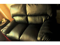 Brand New! Black leather 2 seater reclaining sofa