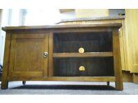 TV unit in medium/light mahogany.