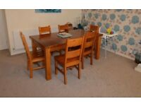 Varnished wooden table and chairs