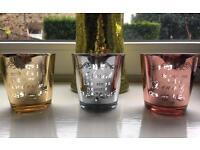 Metallic message tea light holders