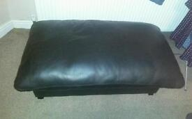 Genuine black leather pouffe.