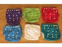 8 Reusable nappies - pocket nappies and 3 microfibre inserts