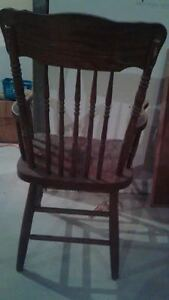 Two solid oak pressed-back Chairs for $10 each London Ontario image 3