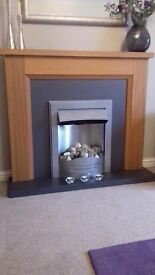 NEXT Oak fire surround with electric fire