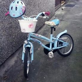 Girls bike for age 5-7 with matching helmet £30