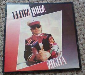 2 Elton John vinyl records