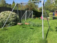 TP brand Triple Giant Swing Frame (Model TP132) for use in garden. Disassembled for transporting.
