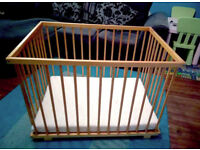 Sturdy wooden playpen with base and mattress