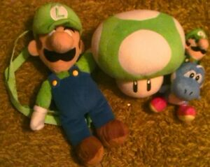 Luigi Backpack, Luigi & Yoshi Plush, and 1 UP Mushroom Plush London Ontario image 1