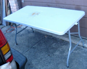 Used Plastic 5' Folding Table, hot spot damage, but functional